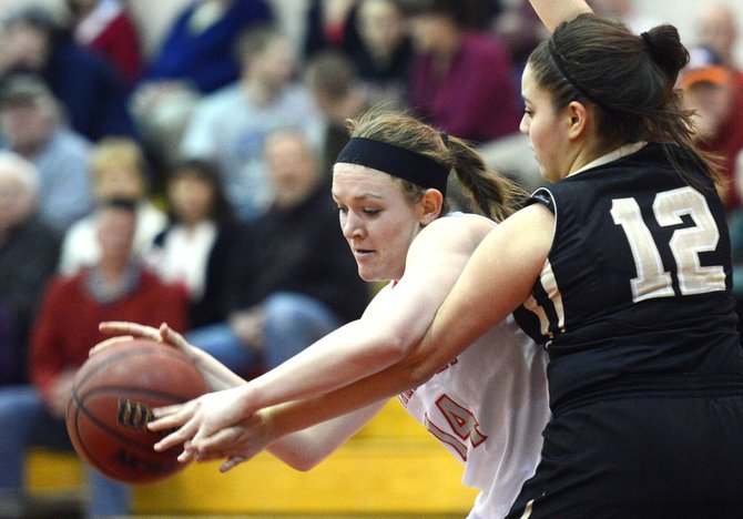 Steamboat senior Nikki Fry drives against Battle Mountain's Iridan Reyes on Friday. The Sailors cruised to a lopsided 62-12 Senior Night win.