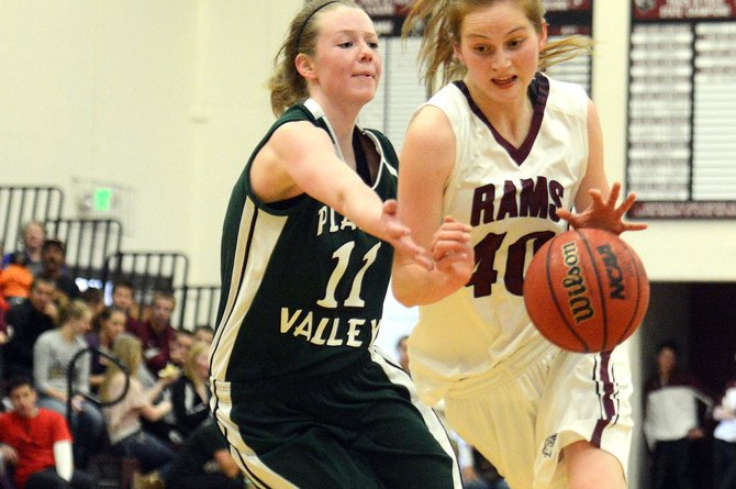 Soroco senior Josie Rossi drives into the lane Saturday in the first half of a game against Plateau Valley and scored on the play, helping spark her Rams out of a slump and on to a victory.