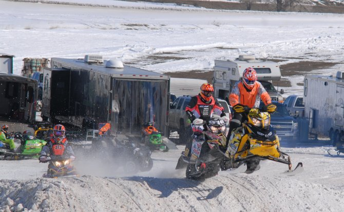 Austin Gabbert of Craig (in orange) jumps out the lead in a Snocross race at Wyman's Winter Festival.