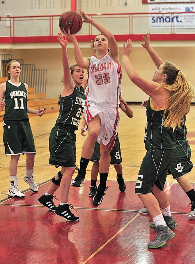 Steamboat's Alice Holmquist drives toward the basket in the first half of Tuesday evening's pigtail game. The Sailors beat Summit County, 50-20, in Steamboat Springs.