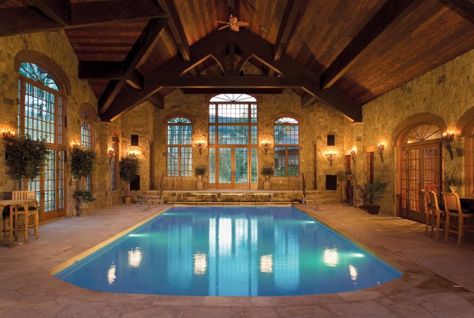 The Mark and Bonnie Porter home overlooking Stagecoach Reservoir from 53 acres above Routt County Road 14 was auctioned Wednesday for $4.62 million. The home is best known for its indoor swimming pool, which is set in a room lined with stone under a vaulted ceiling.