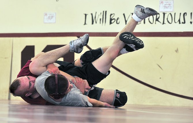 Soroco's 195-pound wrestler Cody Constine prepares for the state high school wrestling championships against Dillon Koler on Wednesday afternoon at Soroco High School. Constine will travel to Denver on Thursday to face Wray's Jonas Cure in the opening round.
