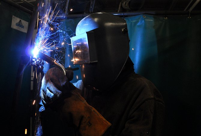 Hayden High School sophomore Kole Miner practices welding Thursday in the Babson Carpenter Career and Technical Education Center. If passed, Sen. Michael Johnston's school finance bill is expected to send more state funding to the Hayden and South Routt school districts.