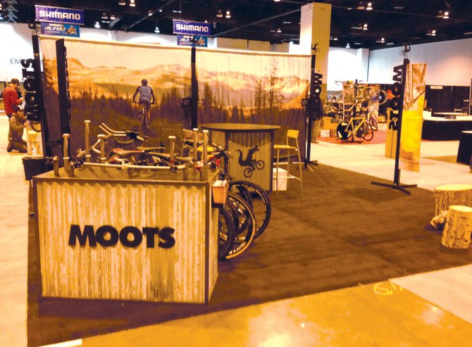 The team at Moots Cycles sets up its booth at the North American Handmade Bicycle Show in Denver on Thursday. The ninth annual traveling trade show will showcase about 170 exhibitors of hand-built bikes from across the world, including two companies from Steamboat Springs. 