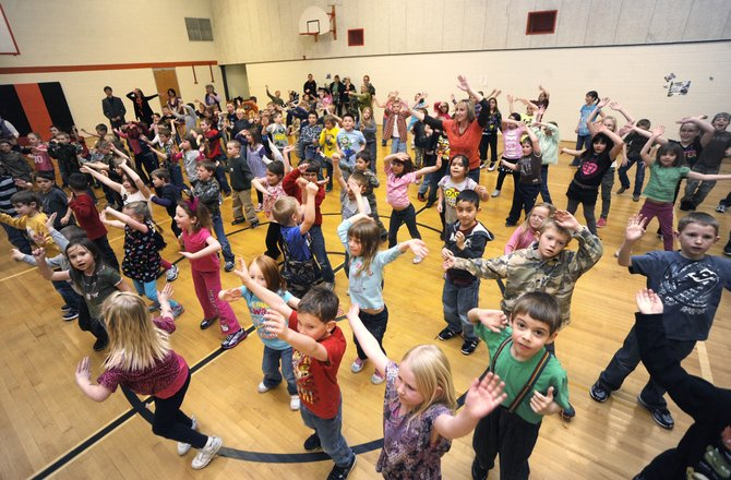 Hayden Valley Elementary School students dance during an Anthem Blue Cross and Blue Shield Get Active, Get Fit assembly hosted Friday by Radio Disney.