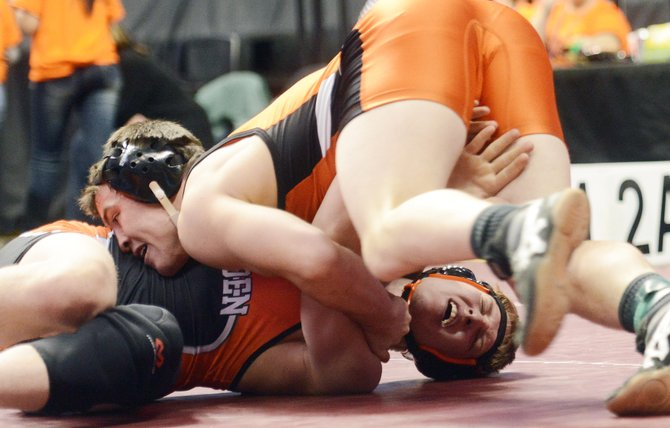 Hayden senior Ryan Domson, bottom, gets rolled by Wiggins senior Garret Walker on Friday at the state wrestling tournament in Denver. Domson lost the match and fell to Saturday&#39;s consolation quarterfinals. Hayden and Soroco picked up several dramatic wins Friday, but only Domson still is in the tournament.