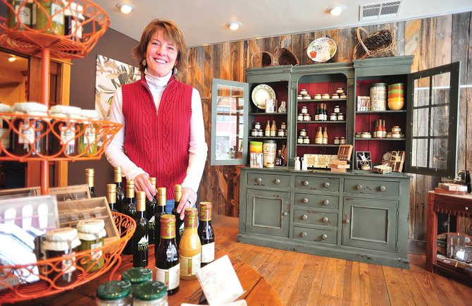 June Lindenmayer, co-owner of Elevated Olive, stands in the new downtown Steamboat Springs business. Lindenmayer opened the specialty store, which features olive oil and vinegars from across the world, along with Carol Parish earlier this month.