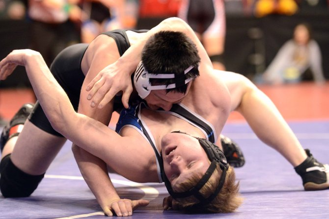Moffat County's Jesse DeMoor wrestles Friday at the state tournament in Denver. Although he lost in the championship quarterfinals early Friday, he earned a quick first-period pin of his first consolation round opponent. He'll wrestle today in the consolation semifinals of the 182-pound Class 3A bracket.