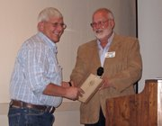 Dave Satterwhite, left, of Brothers Custom Processing accepts the award for small business of the year from Craig Chamber of Commerce Chairman Jeff Smith.