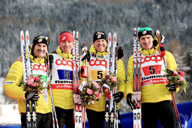 Taylor Fletcher, Billy Demong, Todd Lodwick and Bryan Fletcher celebrate their bronze-medal finish Sunday at the FIS Nordic combined World Championships in the team event in Val di Fiemme, Italy. The team wore lucky American flag mustaches.
