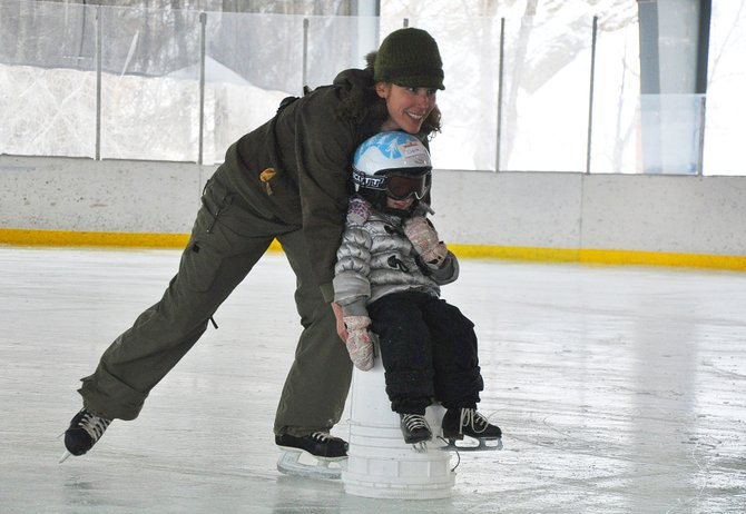 Paula Jaconetta pushes her daughter, Lupita, at the ice rink in Oak Creek. The town this year revived its Winterfest event and hosted a day of ice skating, tubing and sledding. The town now is looking at other wasy to increase its recreational portfolio.