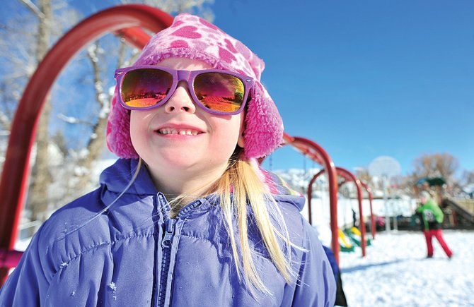 Soda Creek Elementary School kindergartner Bonnie Sue Larson plays at recess Monday afternoon. State Sen. Mike Johnston, D-Denver, is proposing that the state fully fund kindergarten programs at public schools across the state.