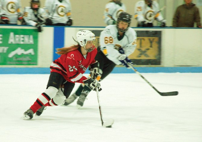Sammy Stabile skates in the puck for the U-14 Steamboat girls hockey team during this weekend's MSGHL championships.