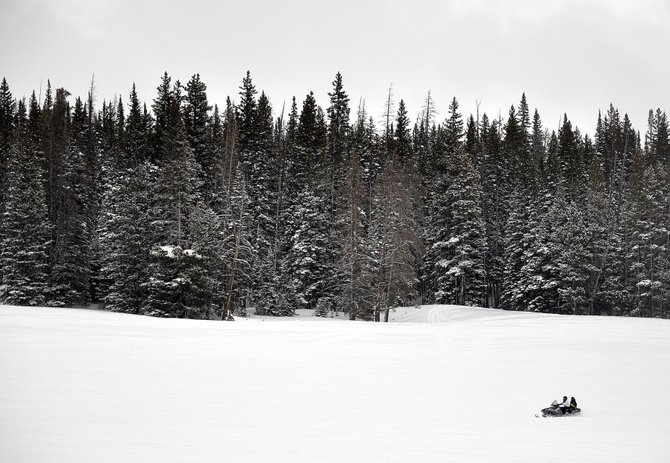 Snowmobilers ride Sunday on Rabbit Ears Pass. The Yampa Valley and surrounding mountains should receive some more snow this week before some warmer temperatures arrive this weekend.