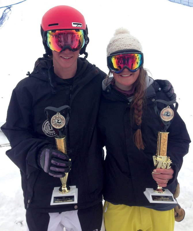 Steamboat Springs Winter Sports Club moguls skiers George DeGrandis, left, and Jaelin Kauf celebrate after winning dual moguls events Sunday at the Rocky Mountain Divisional event.