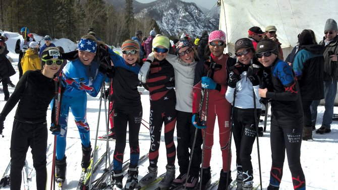Members of the Steamboat Springs Winter Sports Club's J3 and J4 girls cross-country team celebrate after an event in Frisco during the weekend.