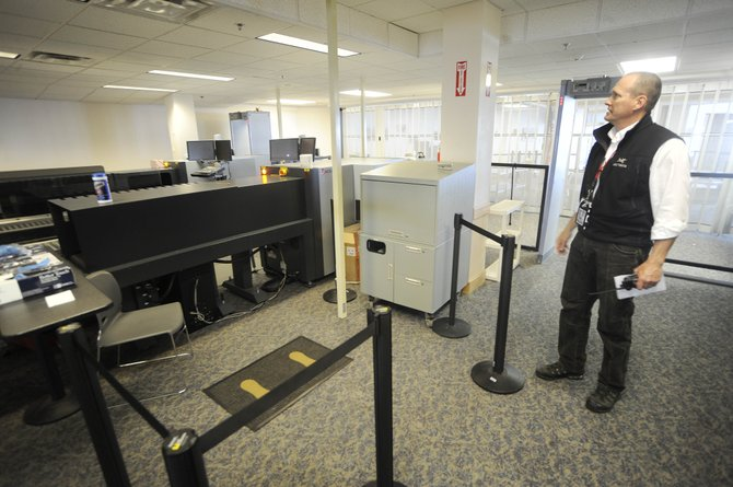 Yampa Valley Regional Airport Manager Dave Ruppel looks at where a full-body scanning machine used to be located at the YVRA security checkpoint. The Transportation Security Administration took the machine this week so it presumably could be used at a larger airport.