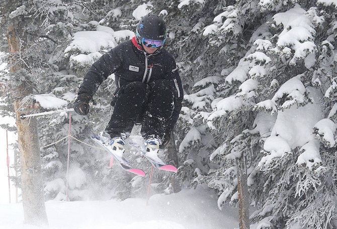 Skier Emily Fisken hits a jump near the top of Buddy's Run at Steamboat Ski Area on Friday morning.