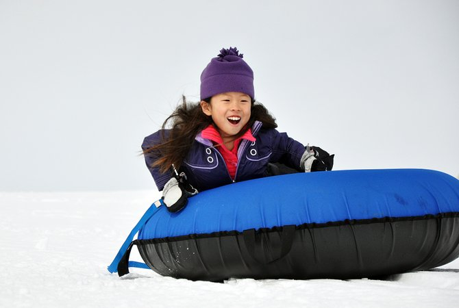 Teegan Barry tubes down a hill Sunday during Cabin Fever Day at Stagecoach State Park.