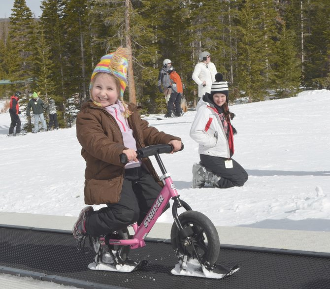 Shayla Stabb, 5, of Broken Bow, Neb., brought her own bicycle fitted with skis to Snowy Range Ski and Recreation Area had a blast making laps on the magic carpet lift. Three generations of the Stabb family spent four days at Snowy Range during Presidents Day weekend.