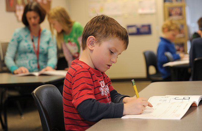 Strawberry Park Elementary School kindergartner Alexander Craig works on a writing lesson in Hadley Nylens class Monday. Without any additional funding from the state, Steamboats full-day kindergarten program is likely to remain tuition-based.