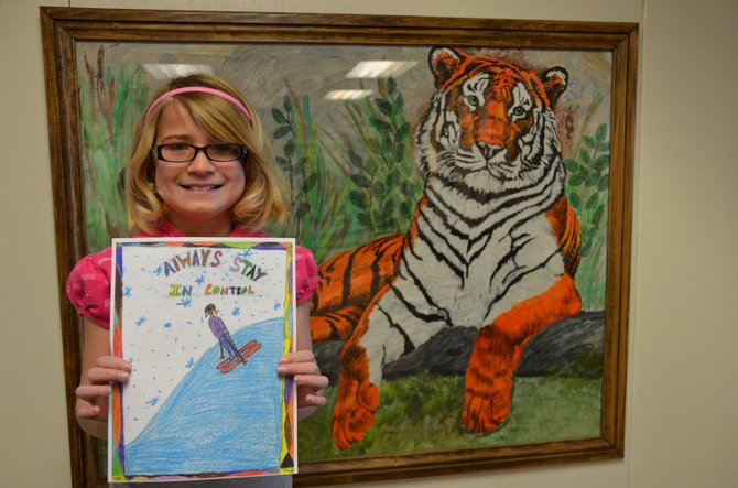 Hayden fourth-grader Whittney Lighthizer poses with her winning drawing for this year's Steamboat Ski Area SlopeWise Ski Safety Poster Contest.