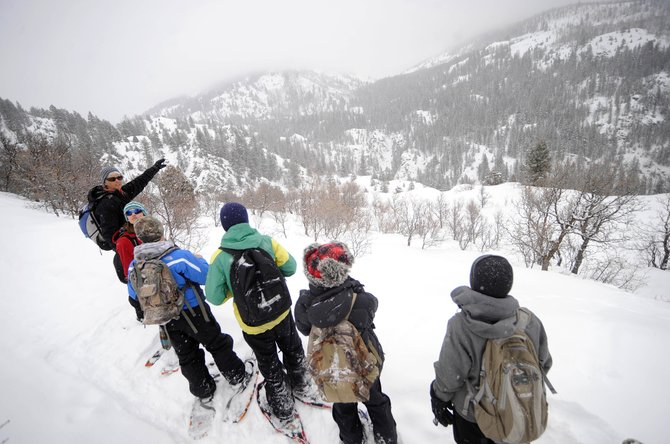 Yampatika naturalist Karen Vail describes the geology in the Fish Creek Canyon area while leading a hike of the Uranium Mine Trail with Steamboat Springs Middle School students. Yampatika gives free snowshoe tours of the trail Fridays.