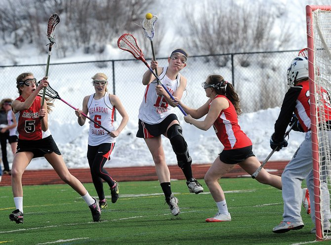 Steamboat Springs senior Nikki Fry shoots and scores in the first half of Friday afternoon's game against Aspen at Gardner Field. The Sailors lost their season opener, 15-6.