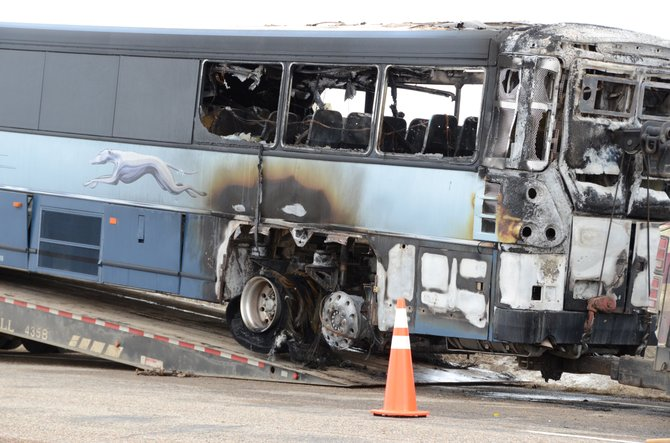 A Greyhound bus caught fire on U.S. Highway 40 west of Craig on Friday after a tire failed. None of the 17 passengers or the driver was injured.