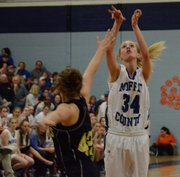 Bailey Hellander puts up a jumper for Moffat County during the regional game against Jefferson Academy Friday.