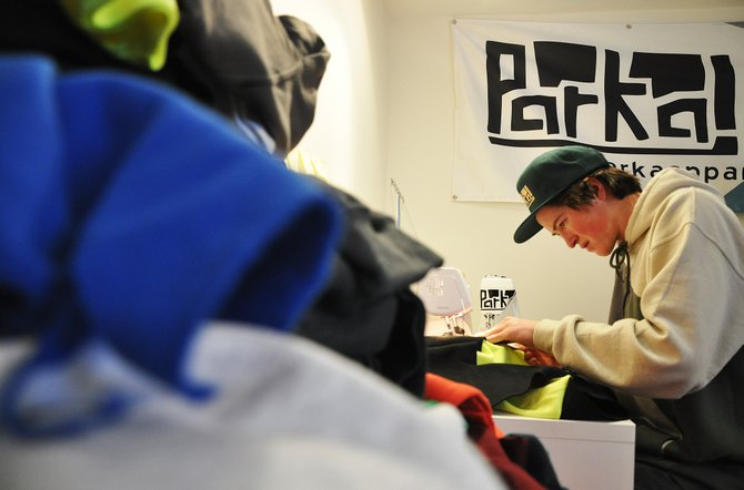 Logan Banning sews a custom sweatshirt Thursday at his home in Steamboat Springs. Banning received $5,000 from the city to support his growing business, Parka.