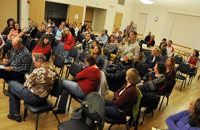 A teacher speaks Monday night during a well-attended joint meeting of the Steamboat Springs School Board and the Steamboat Springs Education Fund Board. The boards discussed the worth of small class sizes and the future of the city's half-cent sales tax for education.