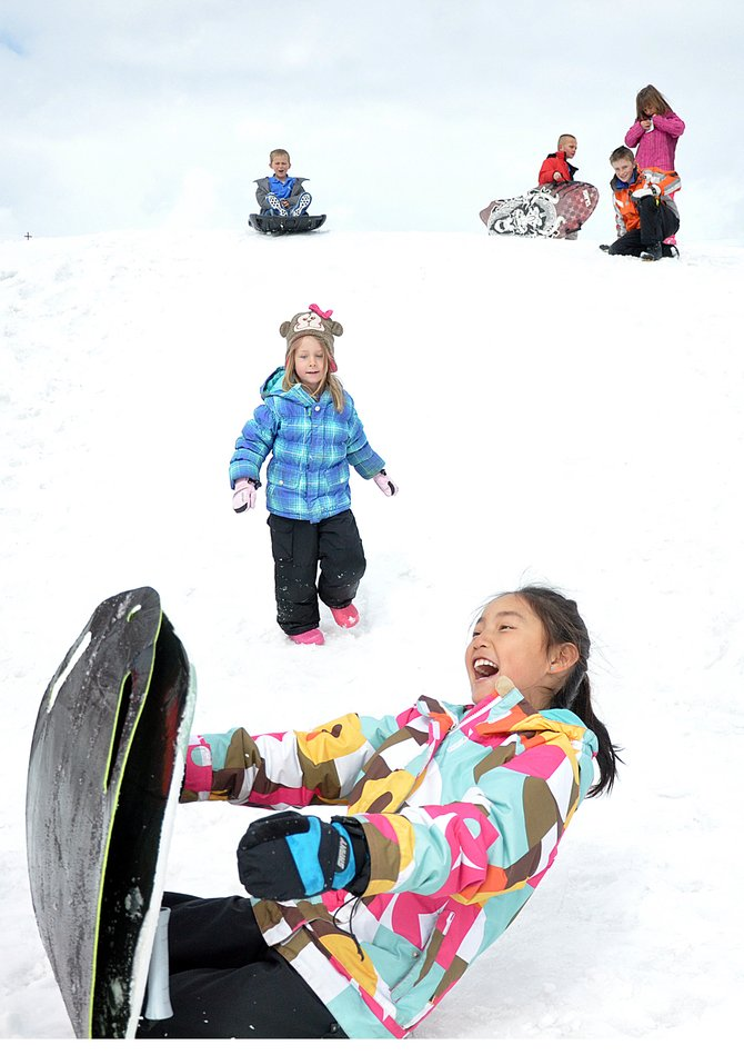 Heritage Christian School student Piper Eivens sleds down a hill Tuesday during recess at the private school west of Steamboat Springs. The campus&#39; school board decided last week to reduce tuition significantly in an effort to attract more students.