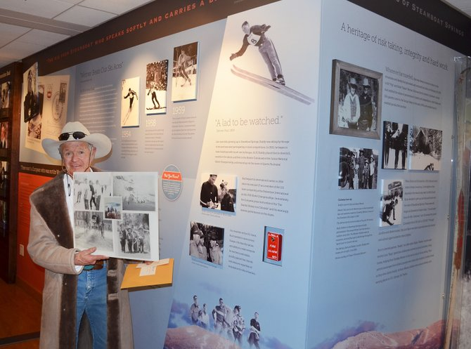 Ray Heid, a first cousin of the late great Olympic ski racer Buddy Werner, displayed personal photos of his relative during the dedication Tuesday night of a permanent history display honoring Werner at the entrance to Library Hall in the Bud Werner Memorial Library.