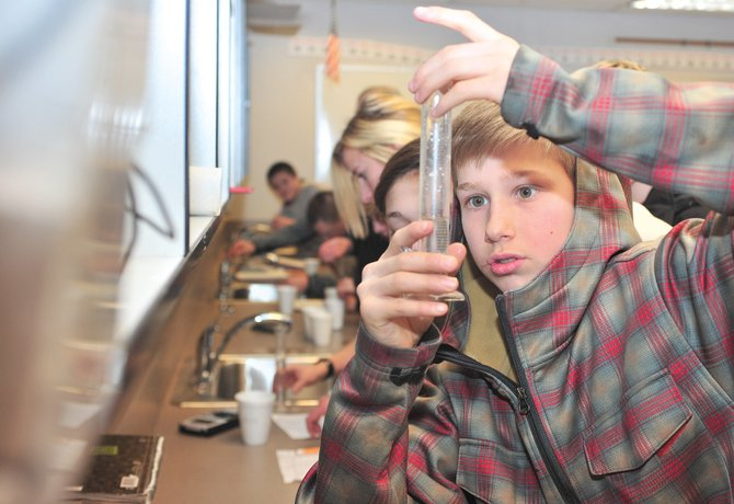 Eighth-grader Jack McNamara performs an experiment in Jennifer Sherman's class at Steamboat Springs Middle School in January. The Steamboat Springs School Board has launched a survey asking community members to prioritize school programs in the district's budget.
