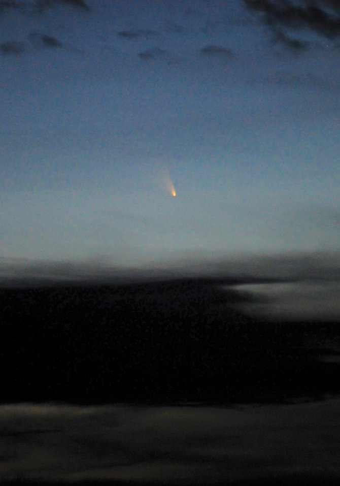 Comet PanSTARRS is no Hale-Bopp, but patient sky watchers can catch a glimpse of the icy interloper just after sundown any clear evening in the next week. While the comet is faintly visible to the unaided eye in the colorful twilight, binoculars will greatly enhance the view and make locating the comet much easier.