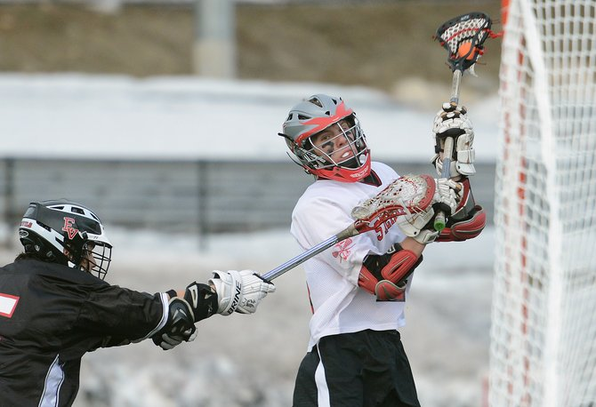 Steamboat senior Dane Dixson swings for a shot Friday against Eagle Valley. He scored on the play, his fourth goal in the 18-4 season-opening win for the Sailors.