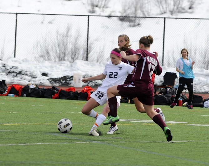 Steamboat Springs High School senior Megan Stabile fights for control of the ball during Saturday's game against Palisade. Steamboat lost, 1-0.