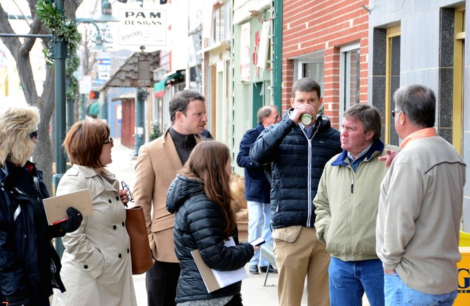 Craig City Manager Jim Ferree, second from right, and Craig Parks and Recreation Director Dave Pike, far right, lead a group of representatives from Downtown Colorado, Inc. on a tour of downtown Craig on Monday. The tour is part of a two-day downtown revitalization assessment that will conclude at 6 p.m. Tuesday with a community presentation.