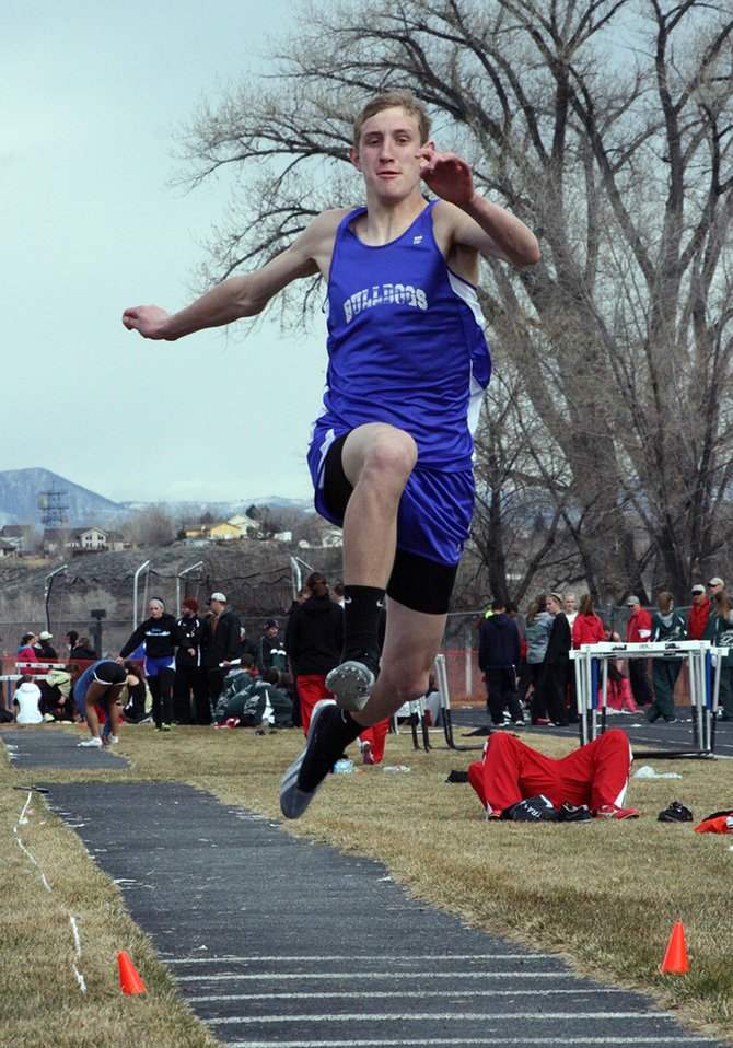 Matt Hamilton competes in the triple jump Saturday at the Rifle Invitational. Hamilton's jump of 39 feet, 6 inches was good for second place.