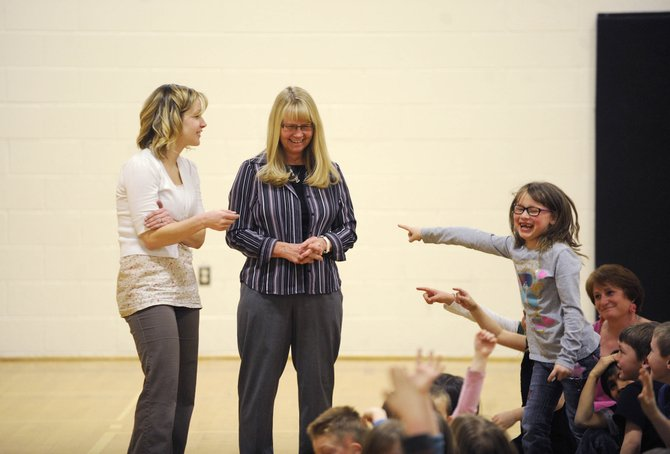 Hayden Valley Elementary School first-graders point to their teacher, Lori Hornstein, middle, after learning Thursday she was named a Peabody Energy Leader in Education.