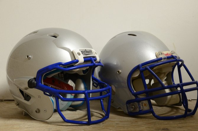 Among the many advances in head injury science in recent years are improved helmets. The helmet on the left is a one-year-old model used by the Moffat County High School football team. The one on the right is about five years old.