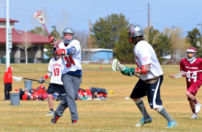 Sam Samlowski makes the pass to Logan Banning in a 16-0 victory against Telluride on Saturday.