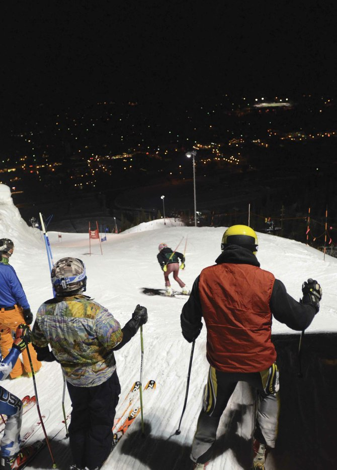 A racer takes off from the starting gate on Howelsen Hill and others wait their turn during the final Town Challenge skiing race of the season. The event drew nearly 40 skiers, up from 2012 but down from the kind of crowds the series drew when it was new, in the 1980s.