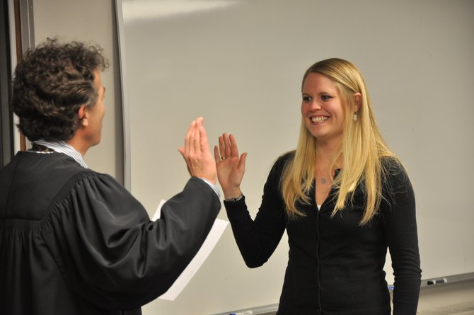 Attorney Paul Sachs swears in Steamboat Springs School Board member Rebecca Williams in 2011. The school board is considering establishing at-large seats to field more candidates.