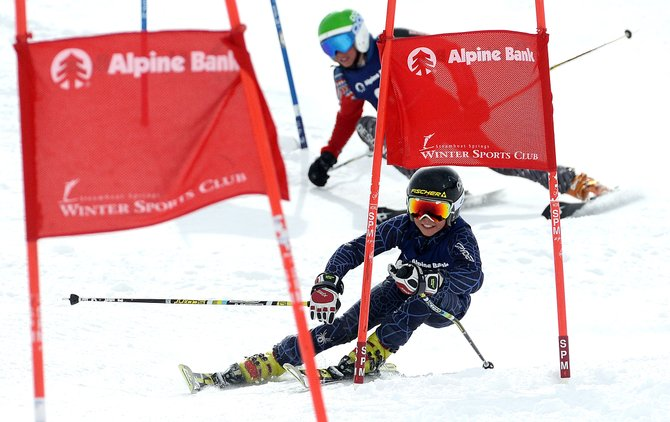 Trey Seymour cuts around a gate in front of Cole Puckett on Sunday during a dual slalom race at Howelsen Hill. Trey Seymour won the U14 division.