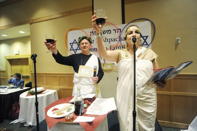 Paula and Randy Salky raise their glasses while leading the Passover Seder on Tuesday at The Steamboat Grand.
