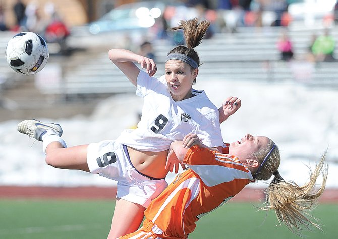 Steamboat Springs senior Megan Stabile collides with a Grand Junction player while getting a loose ball during a soccer game Wednesday afternoon at Gardner Field. The Sailors won, 4-2.