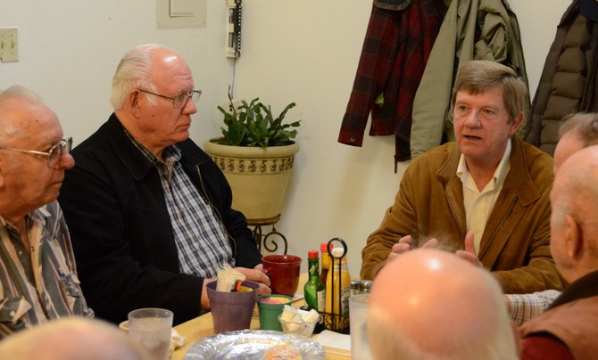 Congressman Scott Tipton, R-Cortez, right, talks with Moffat County residents over coffee at the Cool Water Grille on Wednesday morning. Tipton was in Craig all day Wednesday, meeting with residents, the Moffat County Commissioners and the Bureau of Land Management.