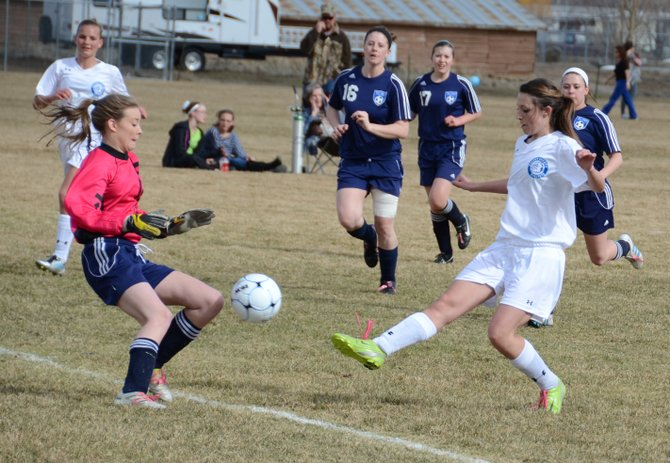 Moffat County's Brittany Walker tries to touch the ball past Vail Christian's goalie in the first half Thursday at Woodbury Sports Complex. Walker did not score but had an assist in Moffat's 5-0 win in its home opener.